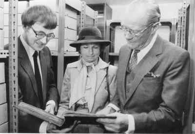 The official opening of the Wellington Suite, 14 May 1983. Dr Chris Woolgar shows a bound volume of the papers to the Duke and Duchess of Wellington.