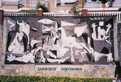 Photograph of a tiled wall in Guernica showing Picasso's painting, originally produced in response to the bombing of the town during the Spanish Civil War