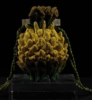 Silk purse shaped as a pineapple